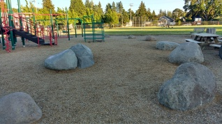 Rocks in playground for seating and play, May Street Elementary, Hood River, OR